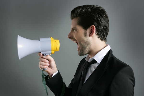 You shouldn't use a loudspeaker, it is better to go to scenic speech courses